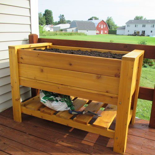 Have to have it. Infinite Cedar Elevated Planter Box with Shelf - $239.99 @hayneedle
