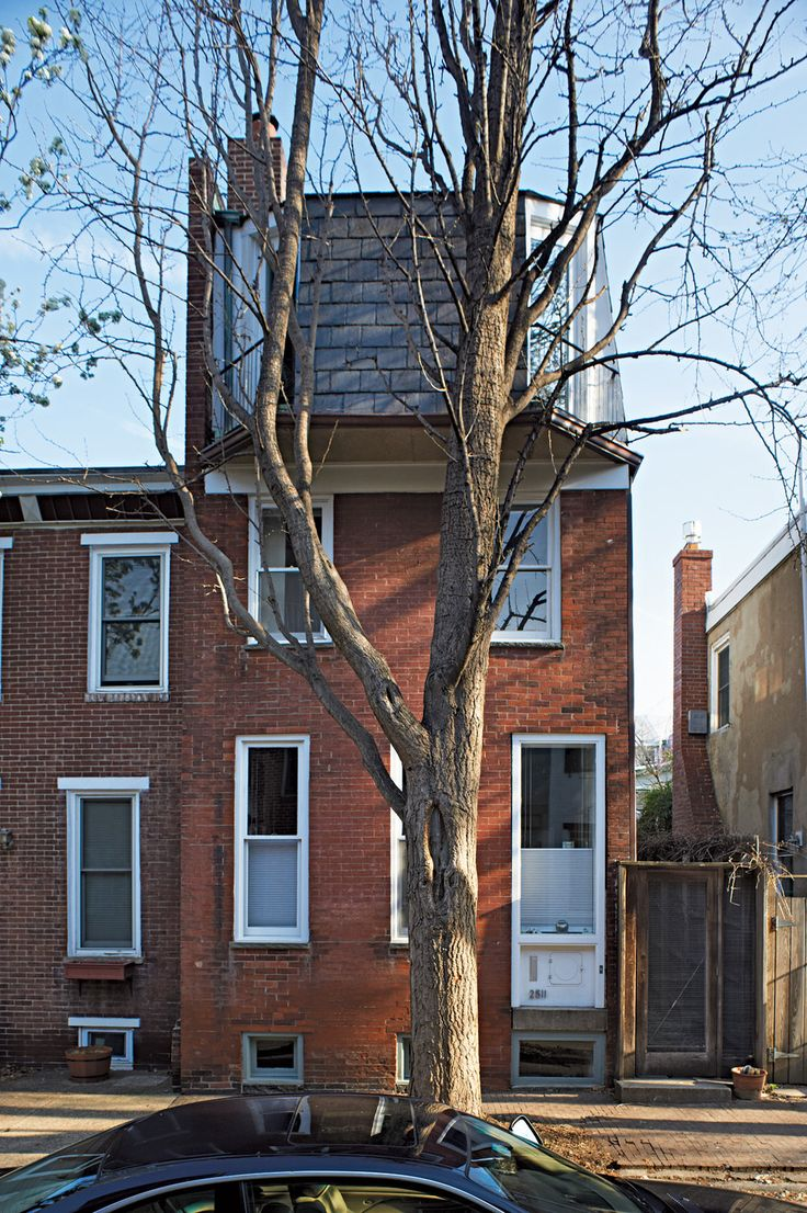 Architect Anne Griswold Tyng added a modern third floor with a mansard roof to her mid-19th century Philadelphia worker's row house in 1967.Tiny House