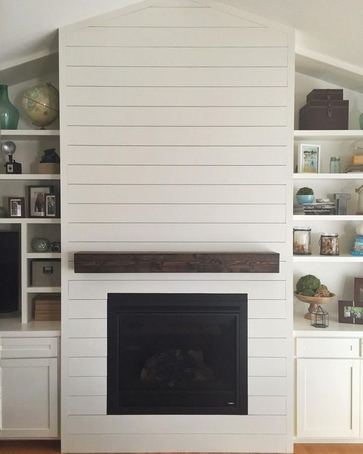 White Brick Fireplace With Shiplap Wall