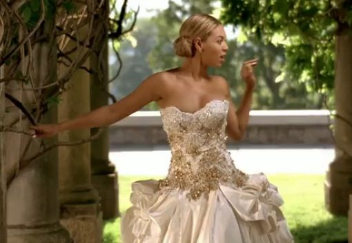 When I saw Beyonce's new video, I completely fell in love with this wedding dress. It;s gorgeous.