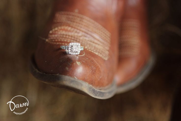 Country wedding photo BUT get a picture of one of the bride's boots and then one of the groom's boots with their rings