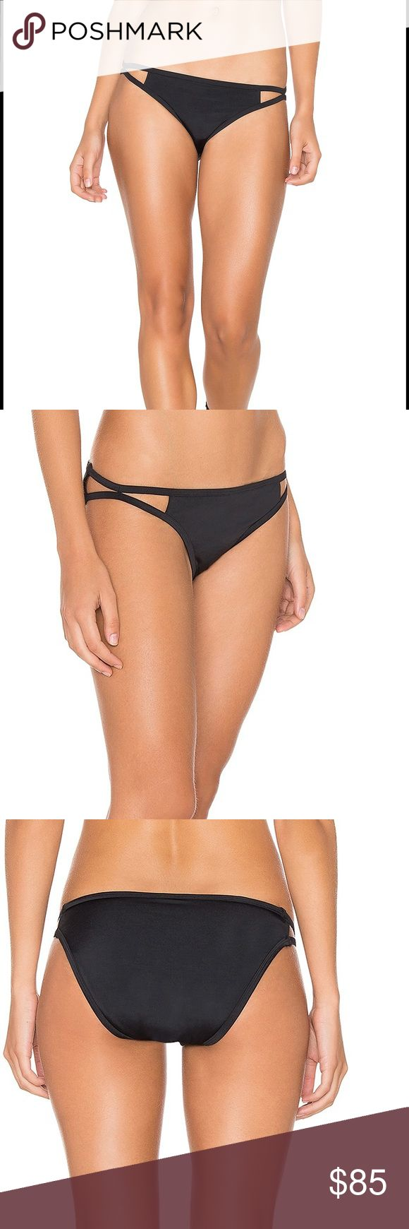 LONELY Black Cut-Out Bikini Bottom Lonely has created a look that is chic and feminine while focusing on wearability and functionality. I fell in love with the design of this bikini bottom when I saw it! Self: 85% nylon , 15% spandex Contrast: 88% nylon , 12% elastane Hand wash cold Color - Black Lonely Swim Bikinis