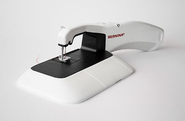 he bermina sewing machine is both stationary and portable thanks to its clever docking system. set it in the dock to use it the conventional way while it charges, or take it out of the dock for freehand stitching on-the-go! design by laura lang
