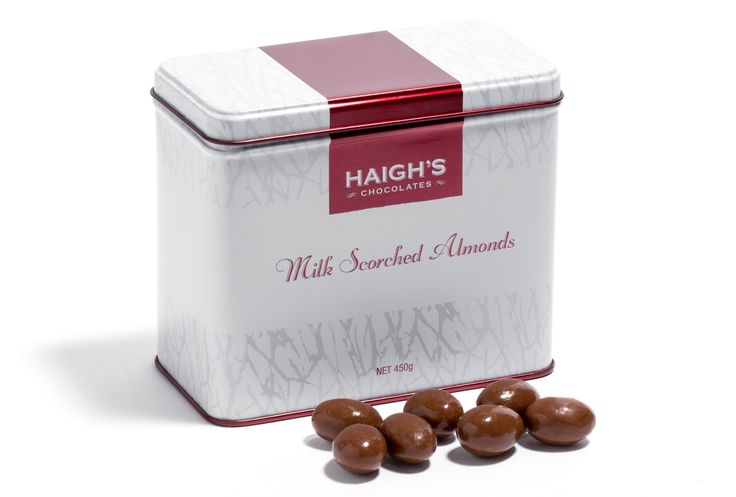 Whole roasted South Australian almonds, pan coated in layers of premium milk chocolate in a white gift tin. #safood #premium #chocolate #haighsonline $31 AUD