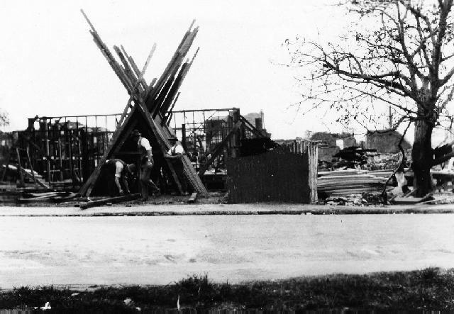 Rebuilding, Hawke's Bay W75 (c), 78660 A photograph of construction work taken after the 1931 Hawke's Bay earthquake. A new building is in...