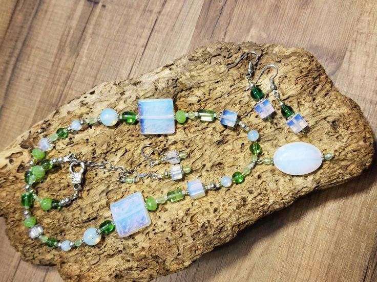Made with Sea Opal glass, I love the color of it. I had to add shades of green's to it. I also made 2 different pairs of earring that match.