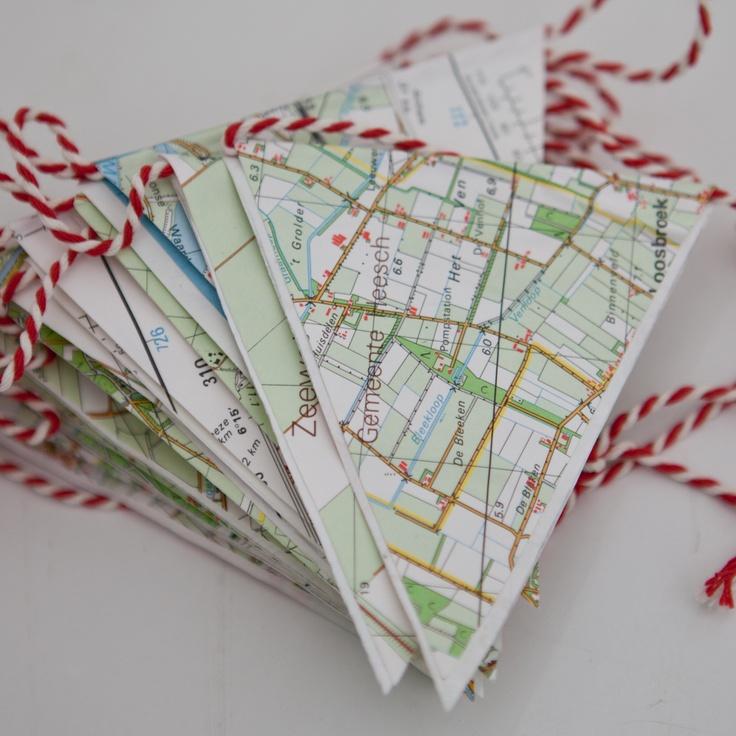 MapFlags:  Heb je iets te vieren? Dan mogen deze originele slingers van het merk Rescued niet ontbreken. Ze zijn gemaakt van oude landkaarten! Gered en van gedaante veranderd, op zoek naar een tweede leven…        Kansmaken op een exemplaar van deze stoere slingers? Kijk dan in SNP.NL magazine nr. 27, die op 21 december verschijnt!    Gezien bij I Am Recycled