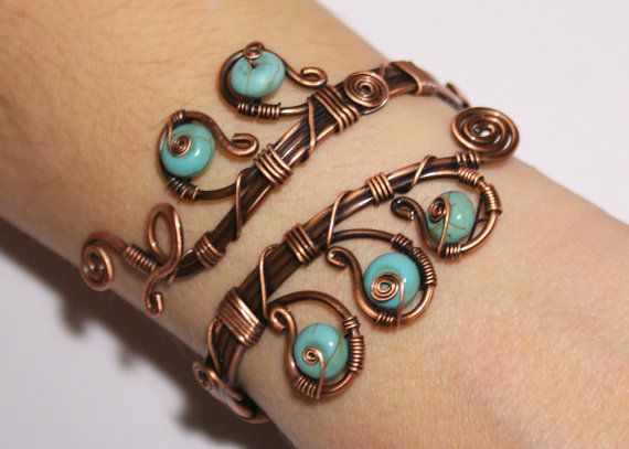 Turquoise cuff bracelet by Beyhan Akman from Turkey - I love how she's incorporated the stones here. The oxidation is a nice touch.