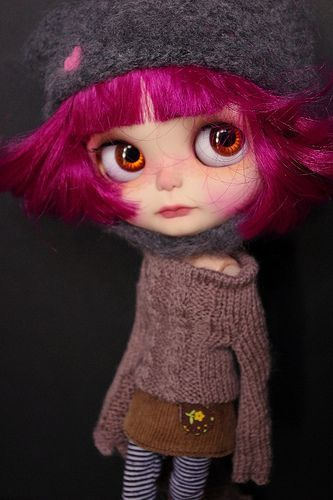 Blythe with bright pink short hair