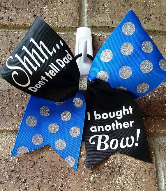 Custom cheer bow made to order. Black and White tick tock style with turquoise glitter polka dots on one side and neon pink lettering on the