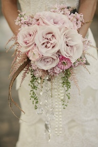 So unique having pearls and crystal accents for bridal bouquet
