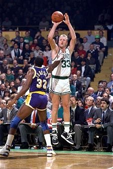 Larry Bird shooting over Magic Johnson of the Los Angles Lakers