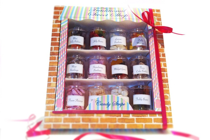 The Traditional Sweet Shop gift set contains 12 individual jars of sweets - contains: Mini Jelly Babies, Jelly Beans, Lemon Bon Bons, Dolly Mixtures, Mint Humbugs, Strawberry Bon Bons, Midget Gems, Fizzy Cola Bottles, Foam Shrimps, Milk Bottles, Mint Imperials and Jelly Teddy Bears. All gift boxed in a traditional sweet shop style.