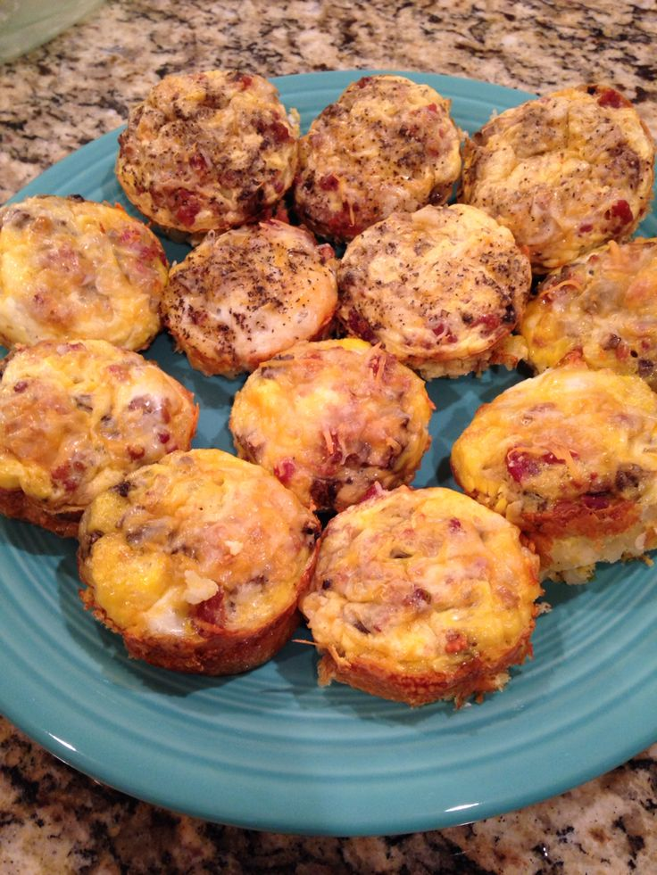 """Breakfast """"muffins"""" 2 weight watchers points plus  Ingredients per muffin, yields 12 -spray each section with butter flavored spray -1tbsp simply potato southwestern potatoes -Chopped fresh mushrooms -1tsp real bacon bits -whisk 1 egg and split between two sections -1tsp mexican blend cheese -salt and pepper to taste  Bake at 350 until eggs are done  You can substitute egg whites or just crack one egg on each, makes it prettier but will be 3 points each.   Refrigerate and heat up in…"""