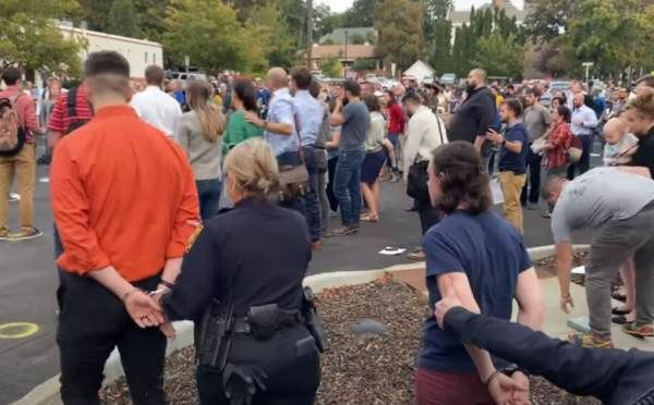 This Is America Three Christians Arrested For Singing Church Hymns Outside In Idaho Without Masks Video Church Hymns Hymn Christianity