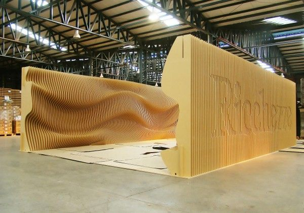 Undulating Sculptural trade show wall created with CNC technology