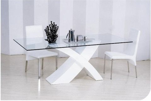 """The X-Table is a classic modern table with its glass table top attached to a white x frame. This piece is luxurious and stylish.  Dimensions: 5'3"""" x 3' x 2'6"""" H"""