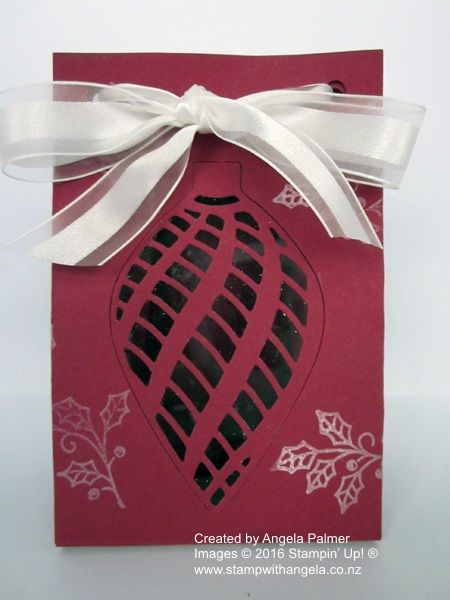 A Christmas Gift Bag made using the Gift Bag Punch Board featuring the Embellished Ornaments stamp set.  The window is made with the Delicate Ornament Thinlits Dies. (Front view)