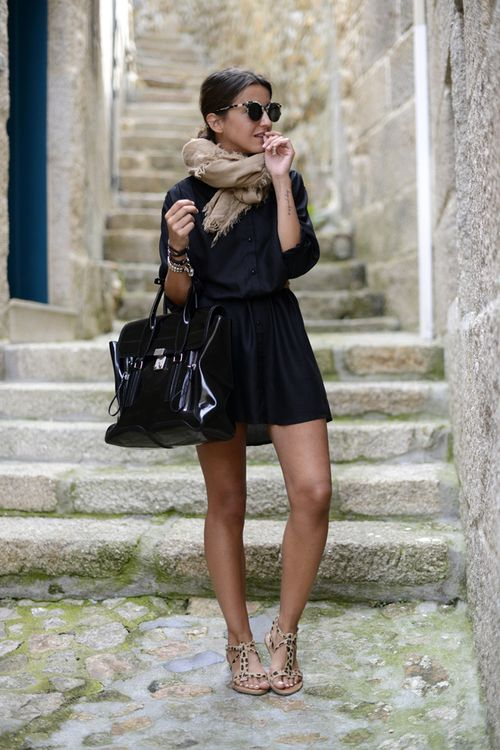 Simple black dress, tan scarf and sandals with black bag.