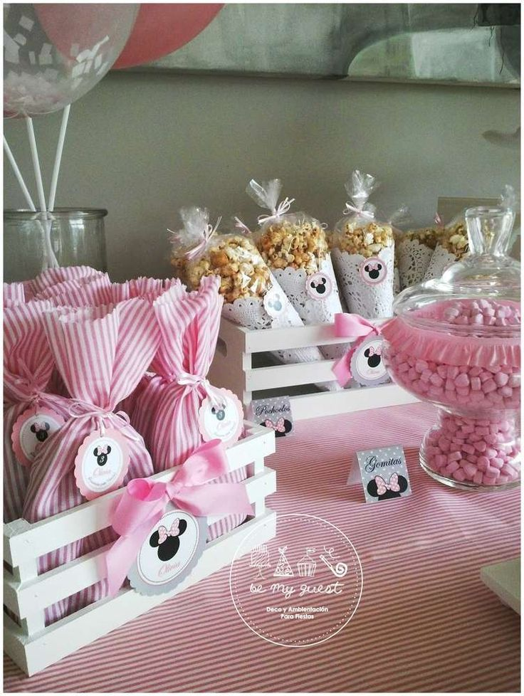 Pink and white favors at a Minnie Mouse birthday party! See more party planning ideas at CatchMyParty.com!