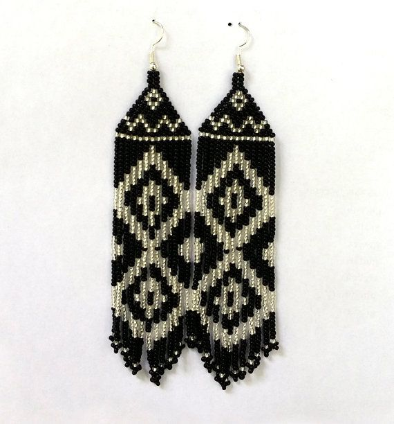 Black silver Earrings. Wonderful and feminine earrings. These earrings are made of black silver seed beads with silver plated ear wires. Length