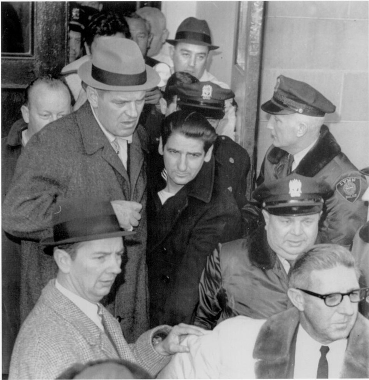 Feb. 25, 1967: Suspected Boston Strangler Albert DeSalvo, wearing sailor's garb, is shown leaving the Lynn police station. His capture ended a nationwide manhunt begun when DeSalvo and two other inmates broke out of Bridgewater State Hospital the previous day.