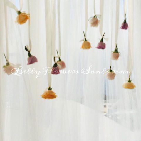 Flowers on hanging ribbons