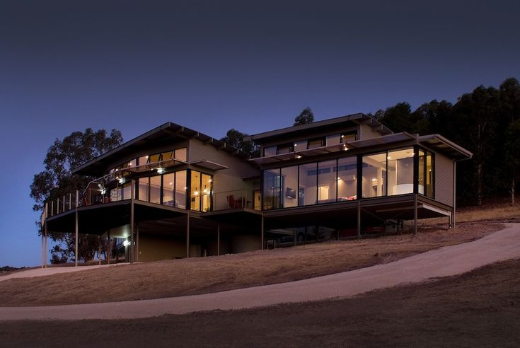 McLaren Eye sits on a beautiful hill in Kangarilla in complete seclusion. Curved alongside the hill, the property's main pavilion invites you to lounge around on the large sofa and take in the breathtaking 180-degree views in the dining area or on the outdoor decking. Private balconies flank the pavilion on each side and offer highest comfort, privacy and style.  Why not arrive in style by Helivista Helicopter.
