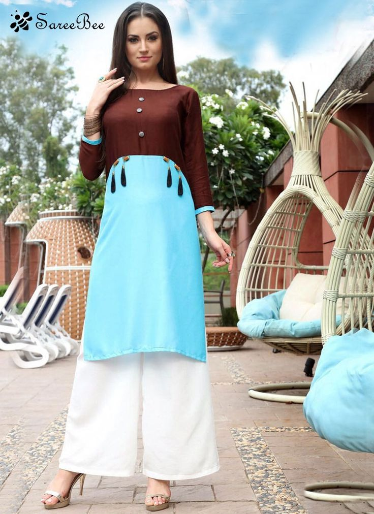 Aspiring Rayon Plain Work Party Wear Kurti  You are bound to make a strong fashion statement with this blue rayon party wear kurti. The plain work seems to be chic and excellent for any celebration.