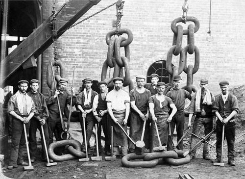 Men building sea anchor chains