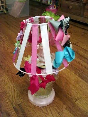 Convert a lamp into a hair-bow holder.