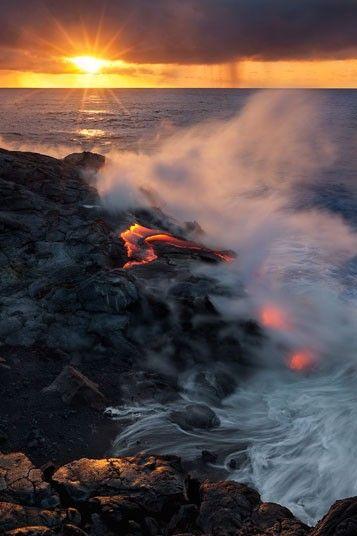 Dawn:  lava flow reaches the sea at the Kilaeua volcano  Picture: Miles Morgan / Barcroft Media