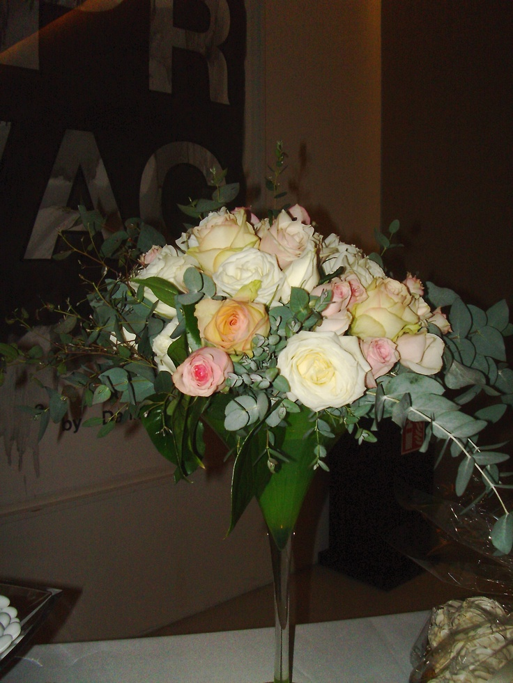 Moustakas flowers-Wedding arrangement with roses and eucalyptus #weddingarrangement #weddingtabledecor #roses