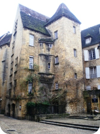 Sarlat, France. The road into town can be a bit busy so when bicycle touring use the paved bike route from the Dordogne River to Sarlat. Shaded, a lovely ride.