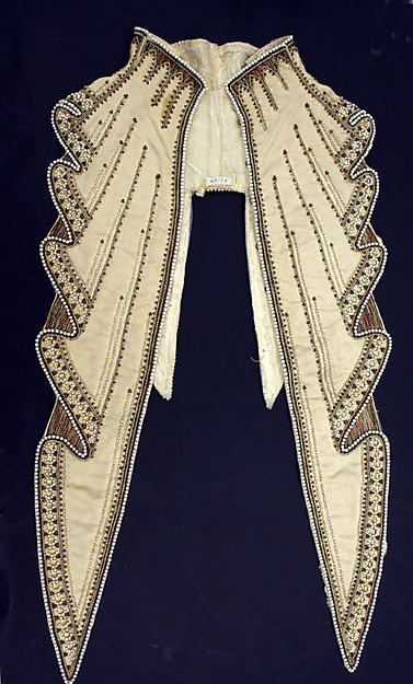 Collar; ca. 1903; note how the flat fabric is decorated to appear to be falling in fluted folds. Lots of pearls!
