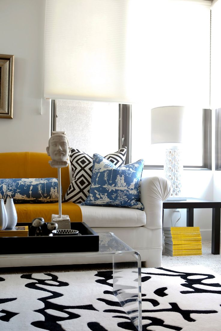 Living room - white, black, caramel, blue, yellow