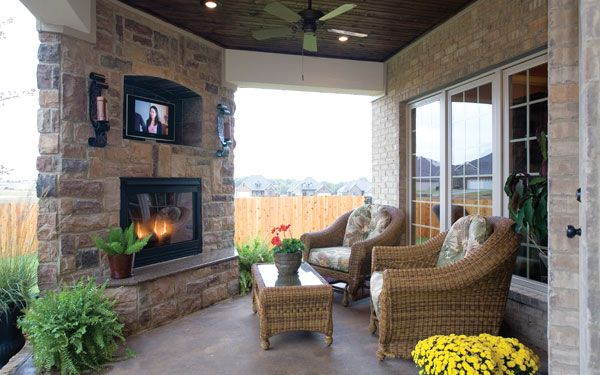 If we can ever build our own place, this is a sure request. So cozy!Covered outdoor fireplace