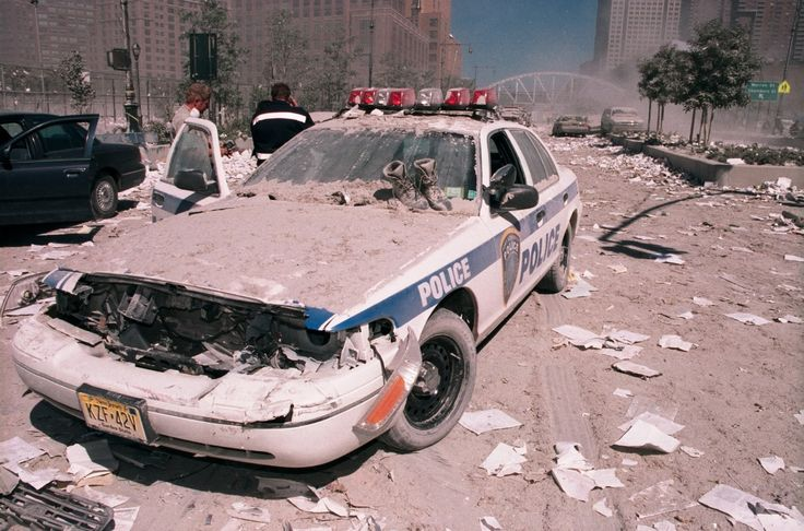 NEW YORK - SEPTEMBER 11: Ash covers a Port Authority police vehicle as it lies on the ground near the area known as Ground Zero after the collapse of the Twin Towers September 11, 2001 in New York City by Anthony Correia on 500px