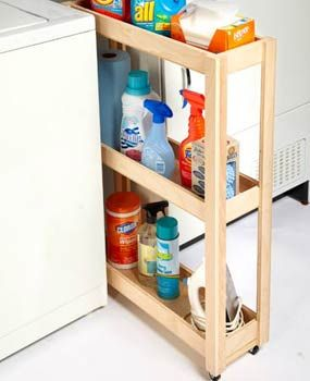 Plywood laundry cart in between the washer and dryer...could also do this with the space by the fridge for other things