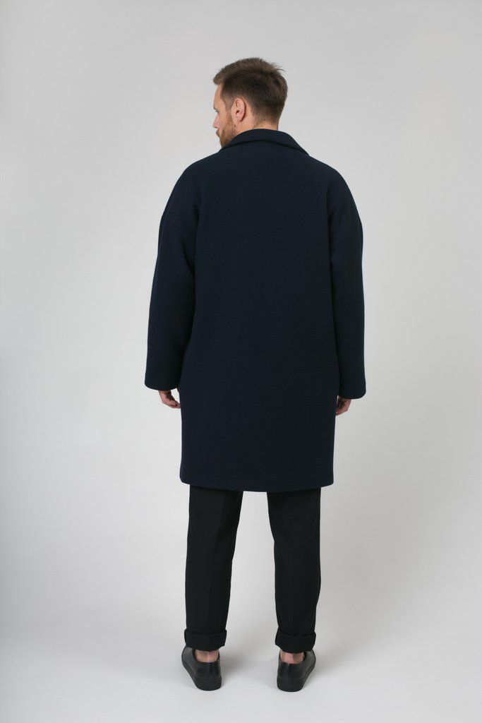 Traditional retail: 5 899 NOK  A timeless knee-long virgin wool coat, with dropped shoulders. It also has a 2 button enclosure in the front, notched lapels and