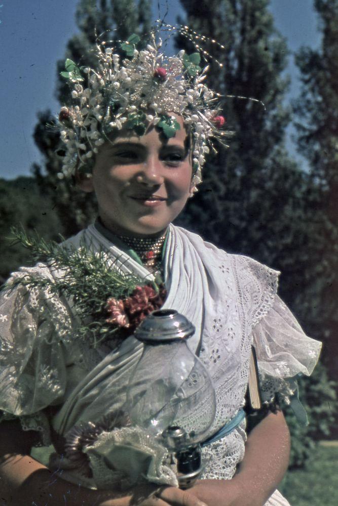 Europe | Portrait of a woman wearing traditional clothesa and headdress, Nógrádsipek, Hungary, 1939