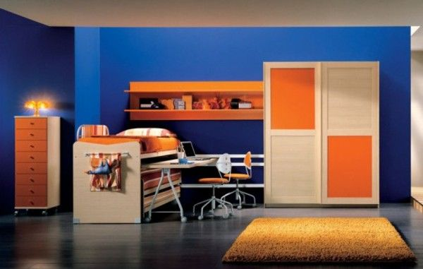 The split complementary colors in this room are dark blue - Orange and light blue bedroom ...