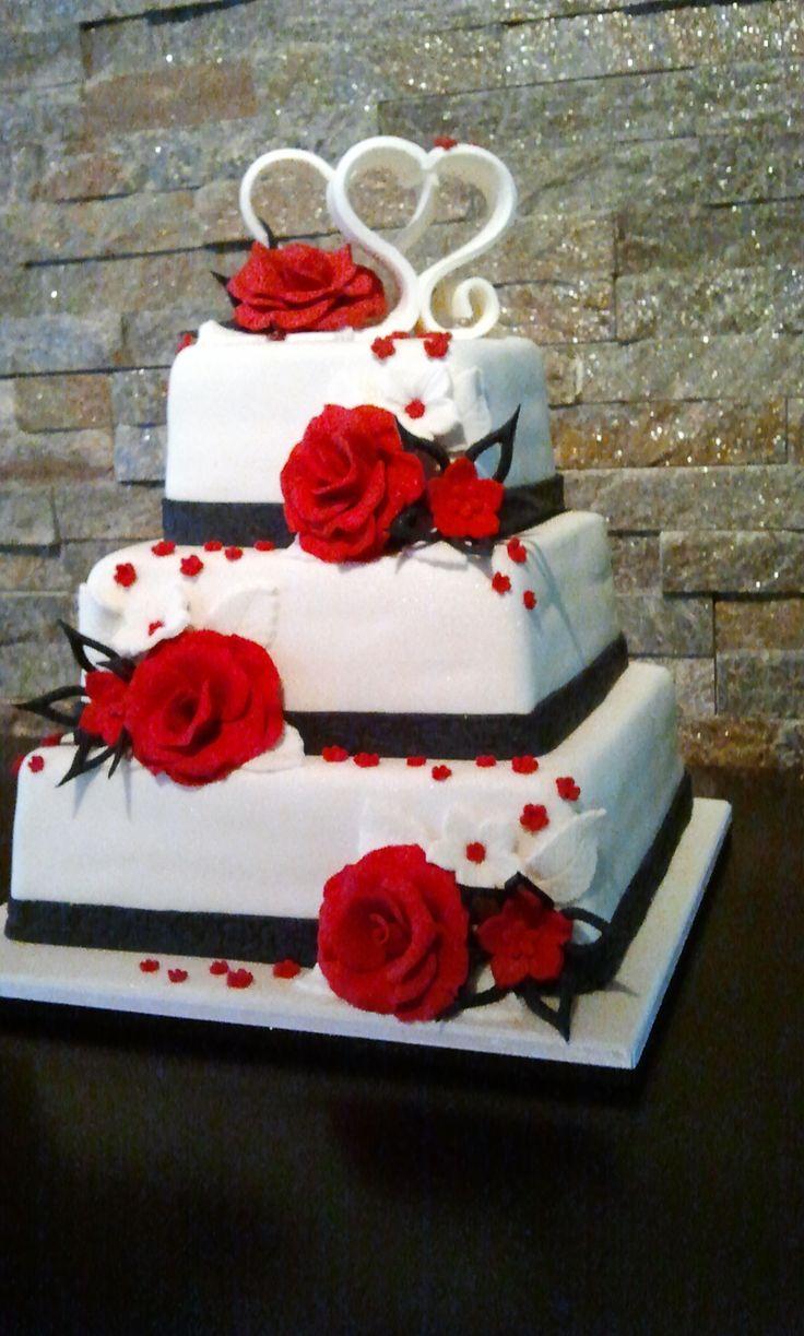 Deze bruidstaart is in de zelfde kleuren als de kleding van het bruidspaar. De taart wordt naar wens gemaakt. www.lutterzand.nl