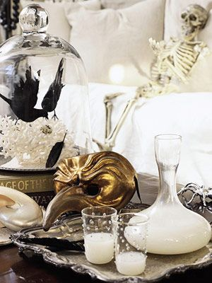 Halloween Decorating. Black, white & gold. Crow under cloche. Love the idea of using Venetian masks as decor