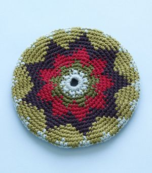 Crochet Coozie/Frisbee - so easy to make and they really fly well.  Great for indoors and out and are machine washable.