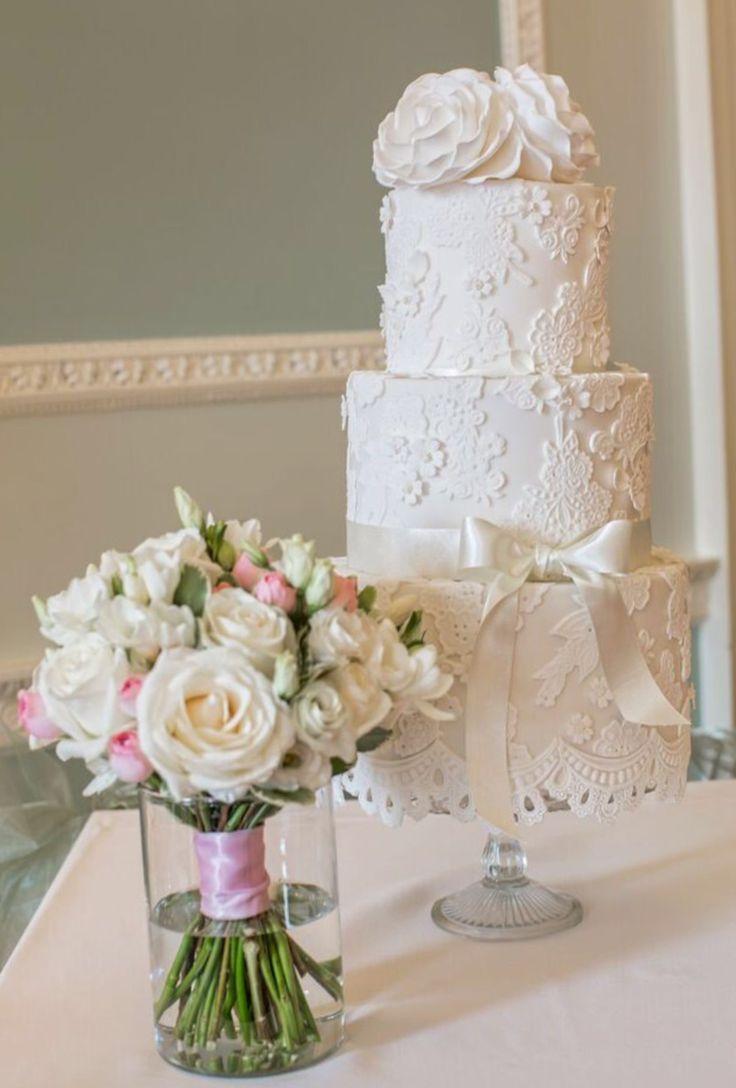 Vintage classic white-on-white lace wedding cake
