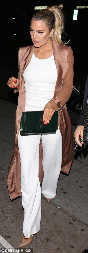 A bit of all white: The gym-obsessed reality star showed off the results of her workout sessions in the pale ensemble