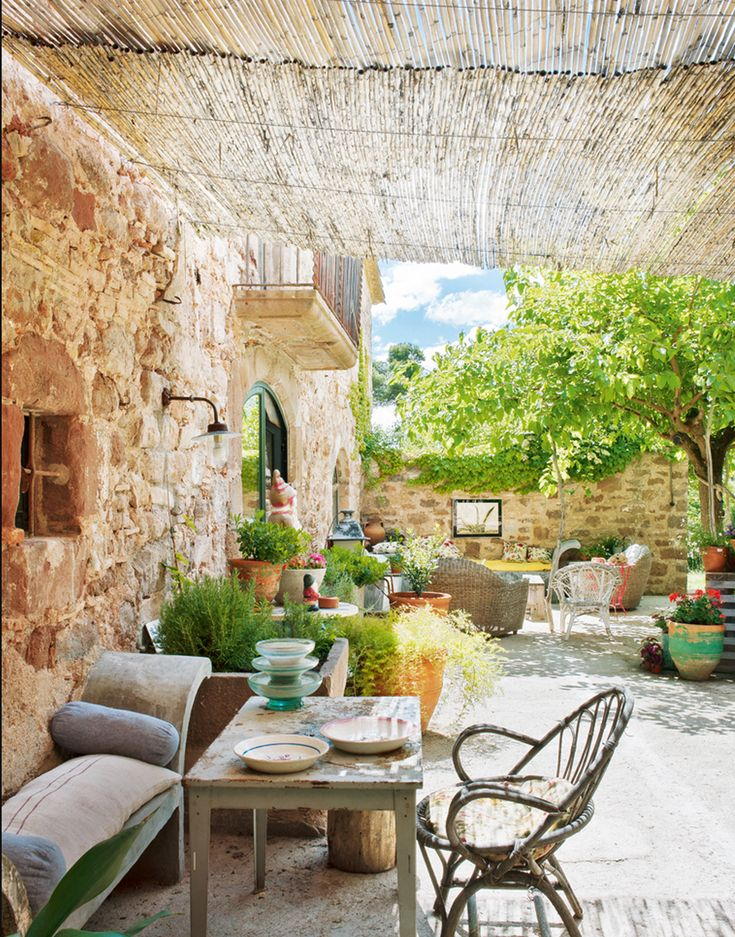 Tucked away in a nature reserve of mountainous Sant Llorenç del Munt, just outside of Barcelona, this restored farmhouse is just oozing with rustic charm and bohemian allure. The eclectic mix of colorful, mismatched details feels effortless yet so stylishly refined.