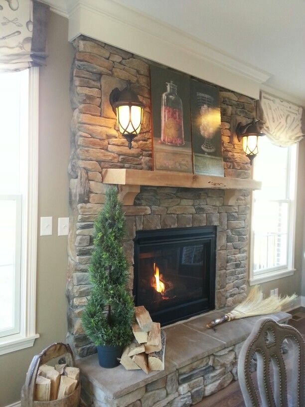 Stacked stone fireplace. This is such a warm and inviting hearth! Plus if it was a gas fireplace.. ☺️