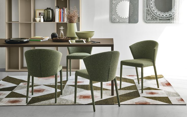 new tosca chair from calligaris with wooden base and fabric or leather seat see it at pinterest